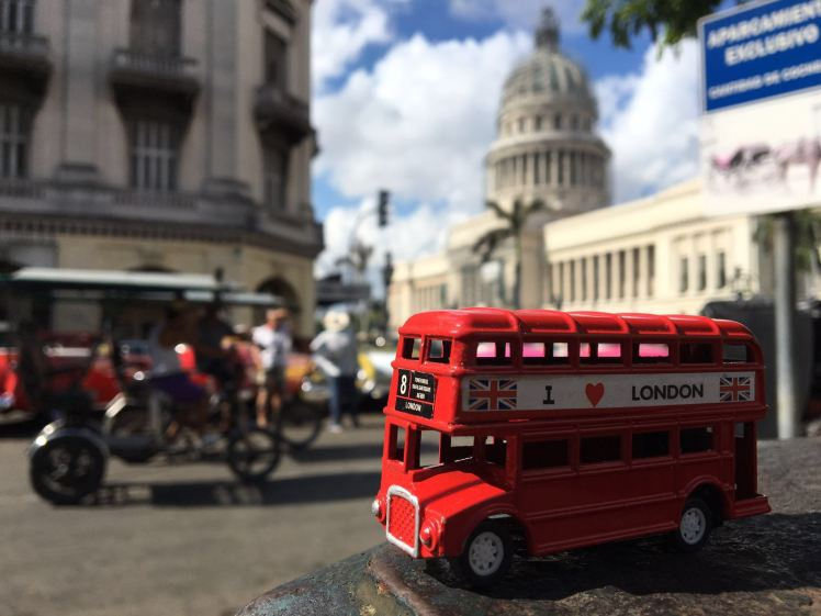 Our little red bus in front of Capitol, Havana